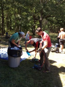 Richard and Brad filling up  Juli and Holly's water packs at Mile 25.